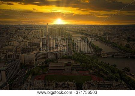 Sunset View From The Eiffel Tower On Paris City, Champs De Mars, Trocadéro And Skyline Toward La Déf