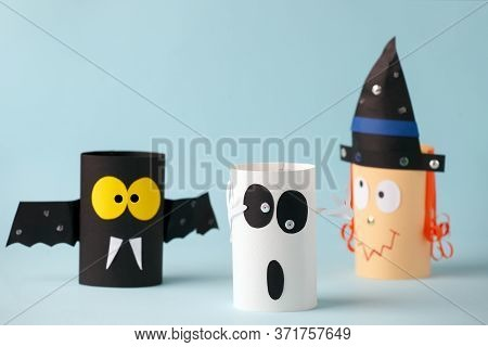 Halloween Toy Collection Ghost, Bat, Witch On Blue For Halloween Concept Background. Paper Crafts, D