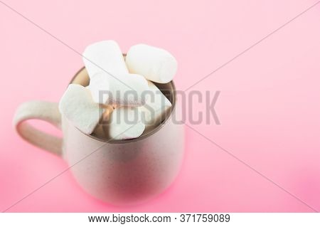 Marshmallows Close-up And Copy Space On A Pink Background. Marshmallows In An Earthenware Mug.