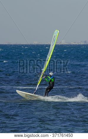 Anapa, Russia-june 15, 2020: Recreational Water Sports. Windsurfing. Windsurfer Surfing The Wind On