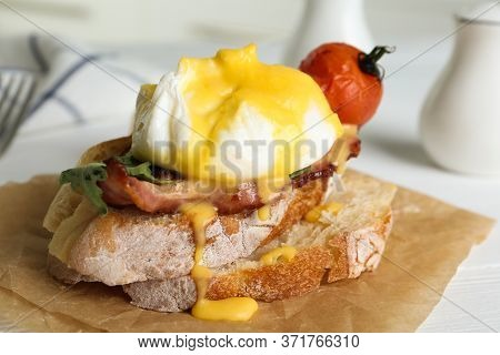 Delicious Egg Benedict Served On Parchment, Closeup