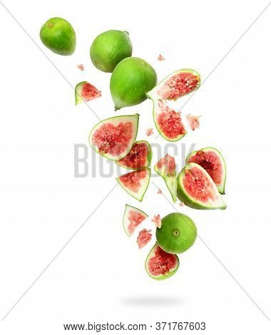 Whole And Sliced Ripe Green Figs In The Air, Isolated On A White Background