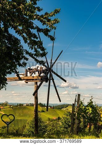 Vineyards Famous Austria Destination Wine Street In South Styria In Summer. View At Windmill On Grap