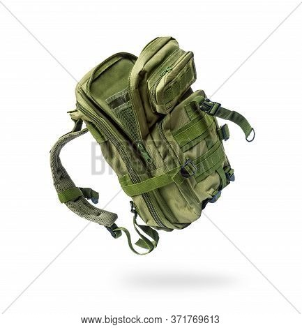 Military Backpack In The Air, Isolated On A White Background