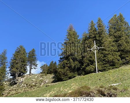 Christian Crucifix On The Hills And Peaks Of The Swiss Mountain Range Of Pilatus And In The Emmental