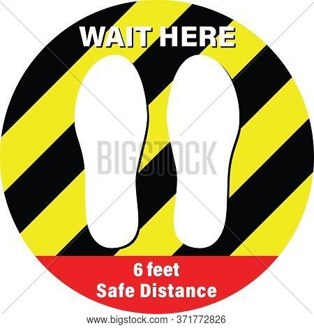 Sticker With The Text , Wait Here, 6 Feet Safe Distance. Yellow And Black Stripes Round Sticker For
