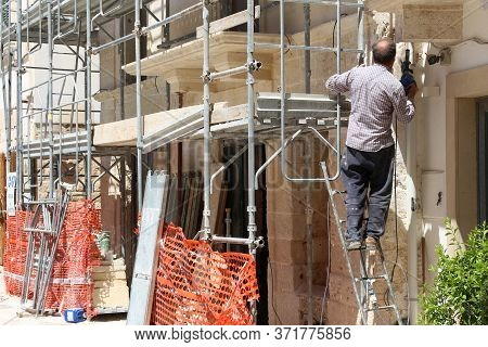 Polignano A Mare, Italy - May 29, 2017: House Renovation Worker Works In Polignano A Mare Old Town I