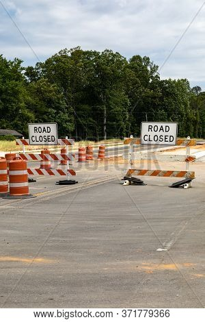 Road Closed Signs On Traffic Barricades, Orange And White Reflective Barrels, Asphalt Copy Space, Ve