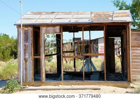 Haunting Image Of An Abandoned Collapsing Shack Taken On Grasslands In An Economically Depressed Com