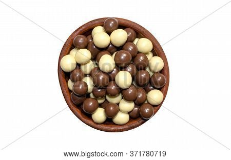 Chocolate Hazelnuts Covered Wit Milk Chocolate And White Chocolate In A Brown Bowl Isolated On White