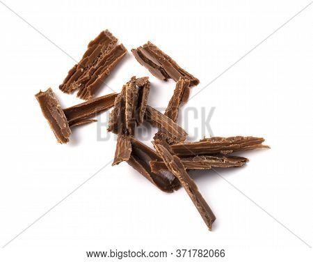 Dark Milk Chocolate Chips Isolated On A White Background. Confectionery Tempered Chocolate From Coco