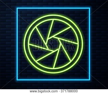 Glowing Neon Line Camera Shutter Icon Isolated On Brick Wall Background. Vector Illustration