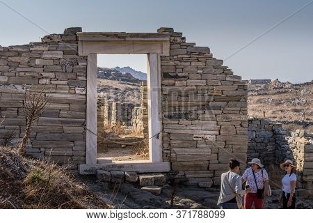 Delos, Greece - Oct 15, 2019. People Visiting Ruins On The Island Of Delos, Greece, An Archaeologica