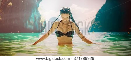 Attractive Bikini Woman In The Water On Exotic Travel Destination. Summer Tourism, Vacation, Holiday