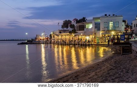 Mykonos, Greece - Oct 16, 2019: Town Of Mykonos As Seen From The Old Harbor In The Evening