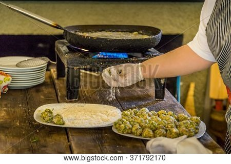 Demonstration Of Greek Cooking Class In Greece
