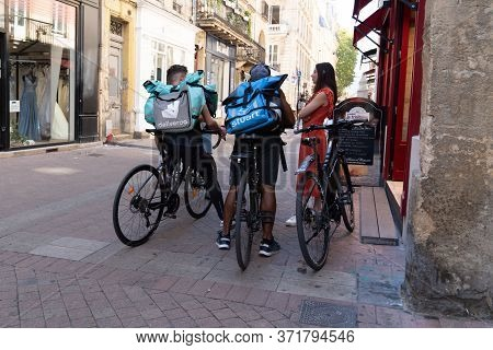 Bordeaux , Aquitaine / France - 11 07 2019 : Group Delivery Man Deliveroo Stuart Bag Pack Looking Ph
