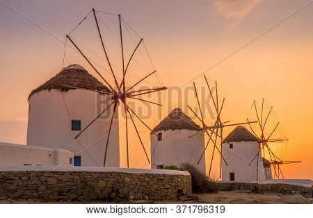 Mykonos, Greece - Oct 14, 2019.  Sun Set View Of Famous And Traditional Greek Windmills In Mykonos I