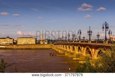 Panorama Of Pont De Pierre, Old Stony Bridge In Bordeaux In A Beautiful Summer Night, France
