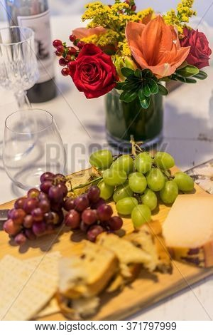 Food, Cheese And Fruit On Table With Beautiful Flower Arrangement