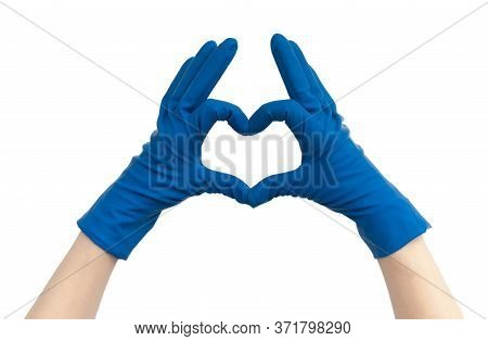 A Female Doctor In Blue Medical Gloves Makes A Heart Out Of Her Hands. Heart Made Of Hands In Blue M