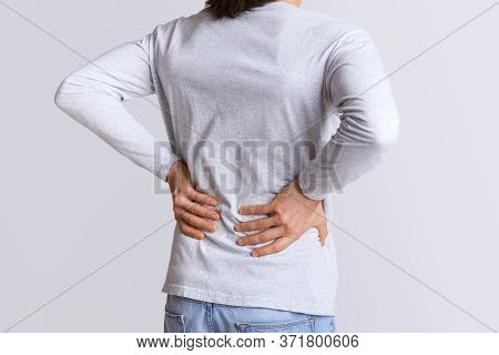 Renal Colic And Back Pain. Man Suffers From Lower Back Pain, Cropped, Studio Shot