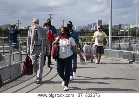 Rio, Brazil - June 16, 2020: People On The Street Wearing A Mask To Protect Themselves From The Coro