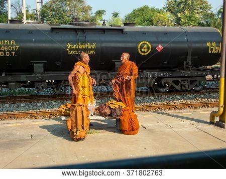 Nakhon Ratchasima Thailand-18 November 2019:thai Buddhist Monks Traveling At Thai Train Station Thro
