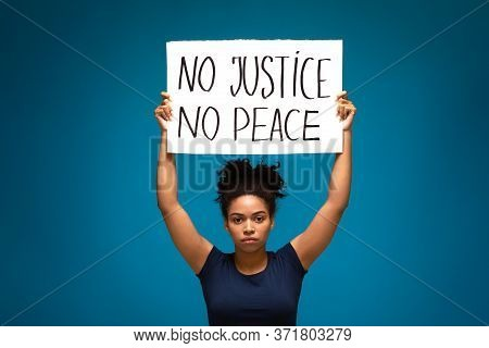 Racism Protest Demonstration. Black Woman Striking With Placard No Justice No Peace, Blue Studio Bac