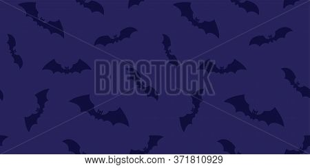 Halloween Bats Seamless Pattern. Dark Flying Bats On Violet Background. Bats Silhouette Ornament For