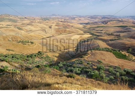 view on hills and fields farm land, scenic view of Sicily summer agriculture
