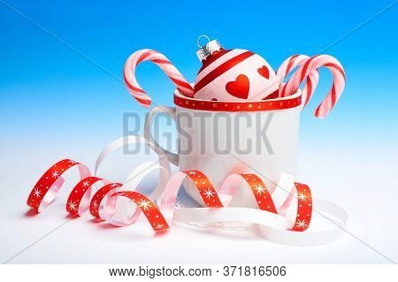 Xmas Bauble With Heart Shape Design, Stripy Candy Canes In Cup And Paper Serpentine. Christmas Decor