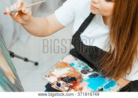 Art, The Work Of The Artist. Young Beautiful Girl Artist Paints A Picture. Workshop Of The Artist. T