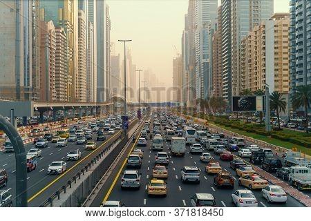 Dubai, Uae - February 2020 : Rush Hour With Many Cars. Traffic Jam In Dubai Downtown City Road Among