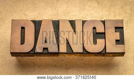 dance - word abstract in vintage letterpress wood type, performing art and entertainment concept