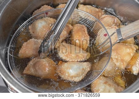 Curry Puff On A White Plate. Curry Puff, Snack Food, Pastries, Stuffed Buns.