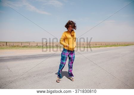 Portrait Of Romantic Happy Female With Blowing Hair Enjoy Weather And Sunny Day Outside. Portrait Of