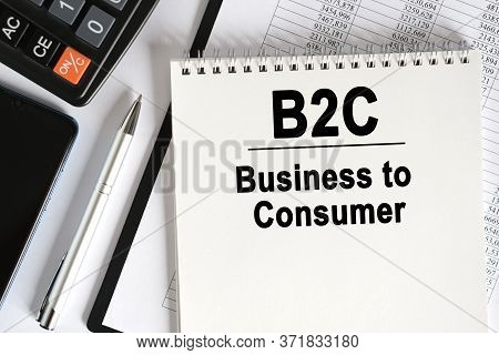 On The Table Lies A Smartphone, A Calculator And A Notebook With The Inscription- B2c. Business To C