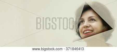 Pretty Business Woman, Successful And Confidence Looks Into The Hole Of Translucent Colored Paper. A