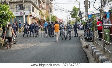 Kathmandu, Nepal - June 12, 2020: Protesters And Riot Police Gather On The Street. Youth Are Protest