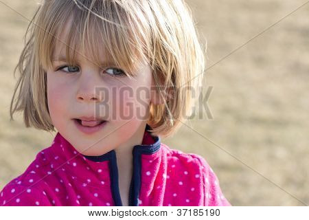 Little Girl With Wary Look