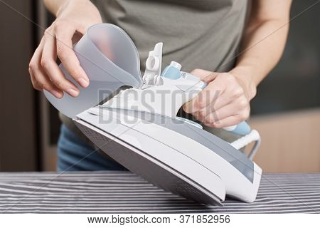 Woman Load Water In Iron. Prepare Iron For Ironing