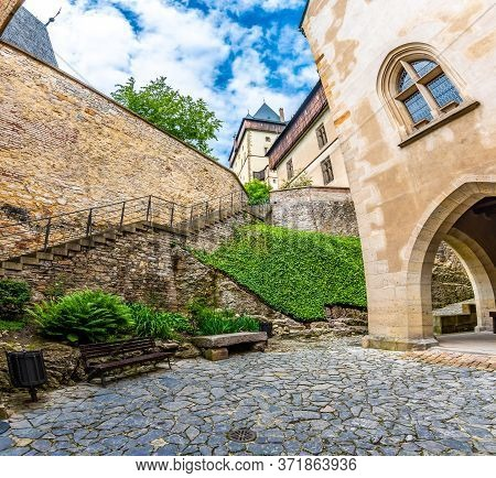 Famous Medieval Gothic Castle Karlstejn On Top Of The Hill. Beautiful Stronghold Is Built By King Ch