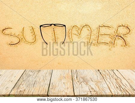 The Word Summer On The Sand Background