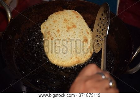 Delicious Bhatoora Or Bhature (fried Bread) Preparation In Progress. Bhatoora Is A Fluffy Deep-fried