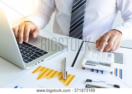Business men are calculating real estate investment expenditures and analyzing the company's finance