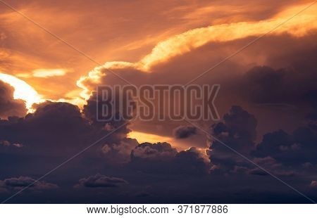 Sunset Sky. Golden Light Shine In Layers Of Clouds. Fluffy Clouds At Dusk. Twilight Sky. God Light.