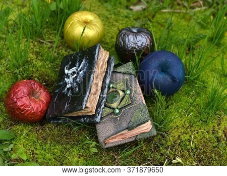Fairy Tale Book With Magic Poisonous Apples In The Garden. Esoteric, Gothic And Occult Background Wi
