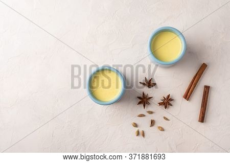 Two Blue Cups With Traditional Indian Masala Chai Tea With On A Light Background. Top View With Copy
