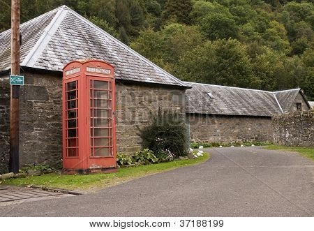 red phonebox by road